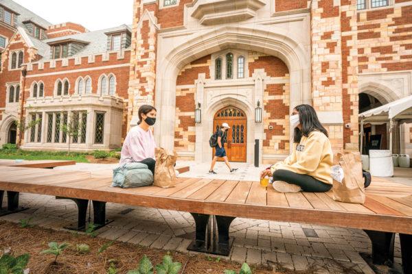 Students share lunch outside E. Bronson Ingram College.