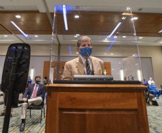 Professor Joe Hamilton at Metro Council podium