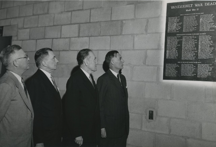 Memorial Gymnasium, dedicated on Dec. 6, 1952, commemorates Vanderbilt veterans who served in World War II. Pictured (l-r) are Charles S. Ragland, general chairman of the Memorial Gymnasium Fund Campaign, 1946-47; James G. Stahlman, chairman of the Board of Trust Gymnasium Committee, 1945-46; Charles Madison Sarratt, dean of students from 1941 to 1946 and vice chancellor from 1946 to 1957; and Chancellor Harvie Branscomb. (Vanderbilt University Special Collections and University Archives)