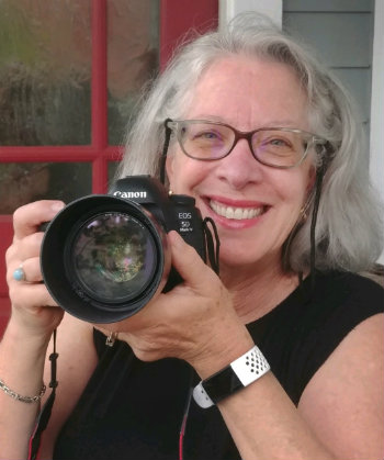 Photographer Kats Barry with her Canon camera