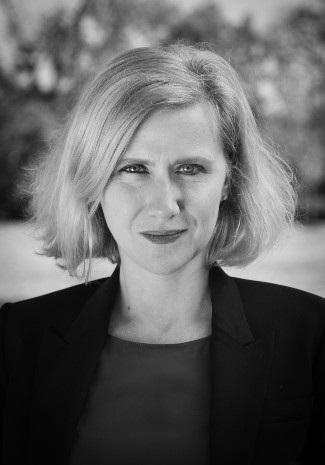 black and white headshot photo of Emily Greble