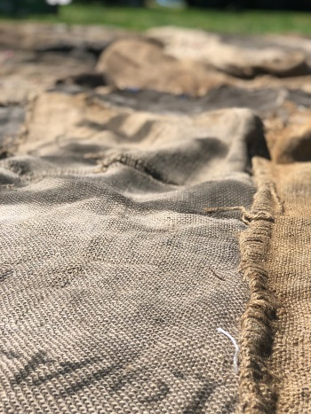 Jute sacks to be sewn together (courtesy of Engine for Art, Democracy and Justice)