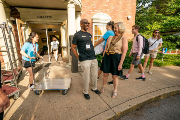 Provost Susan R. Wente talks with Gillette head of house Frank Dobson as they greet new arrivals on The Martha Ingram Commons. (John Russell/Vanderbilt University)