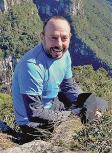 photo of Guilherme Gualda on a mountain trail