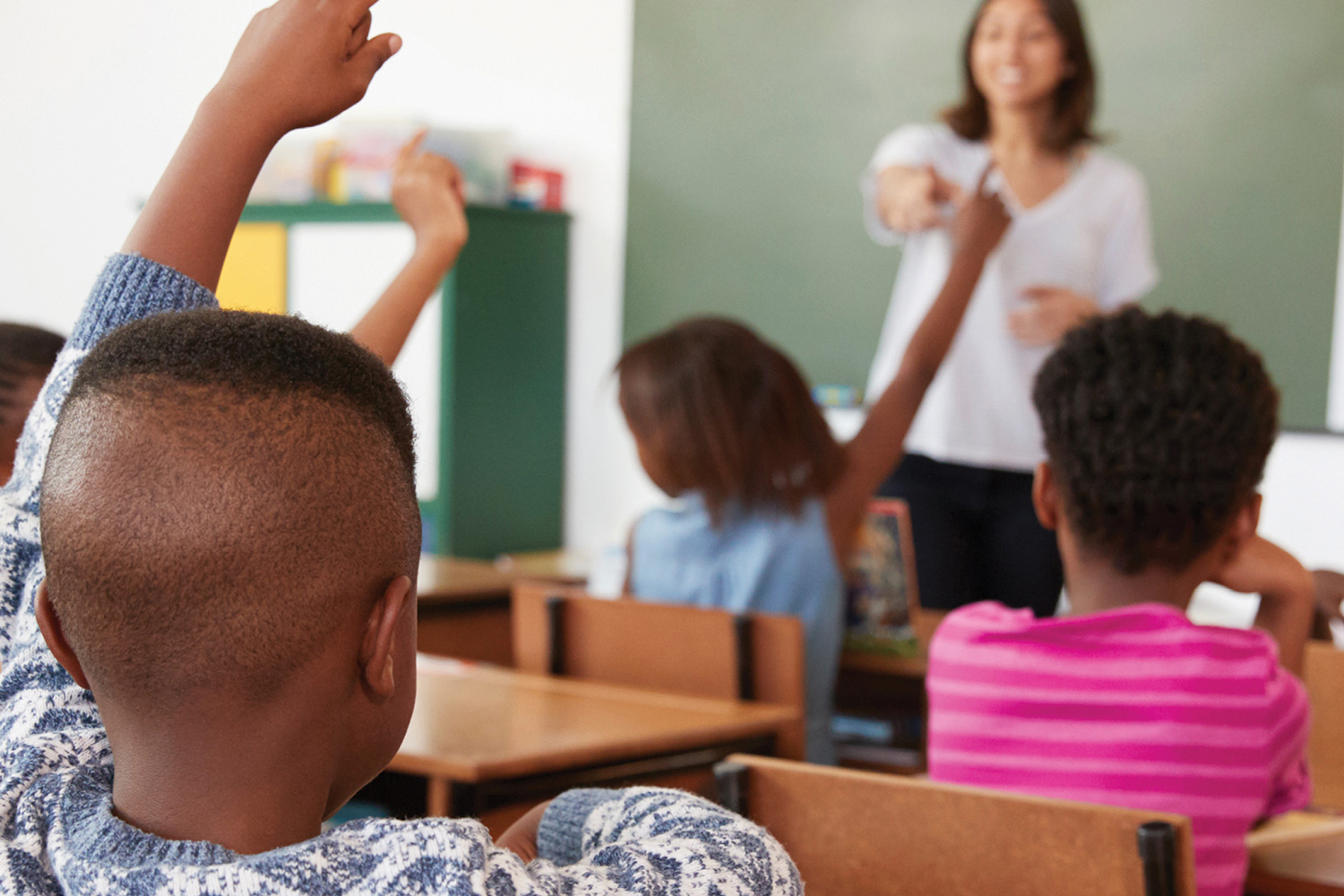 photo of a teacher leading a classroom of African American students