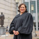 Judge Ana Escobar in her black judges robes outside the Justice A.A. Birch courthouse in Nashville
