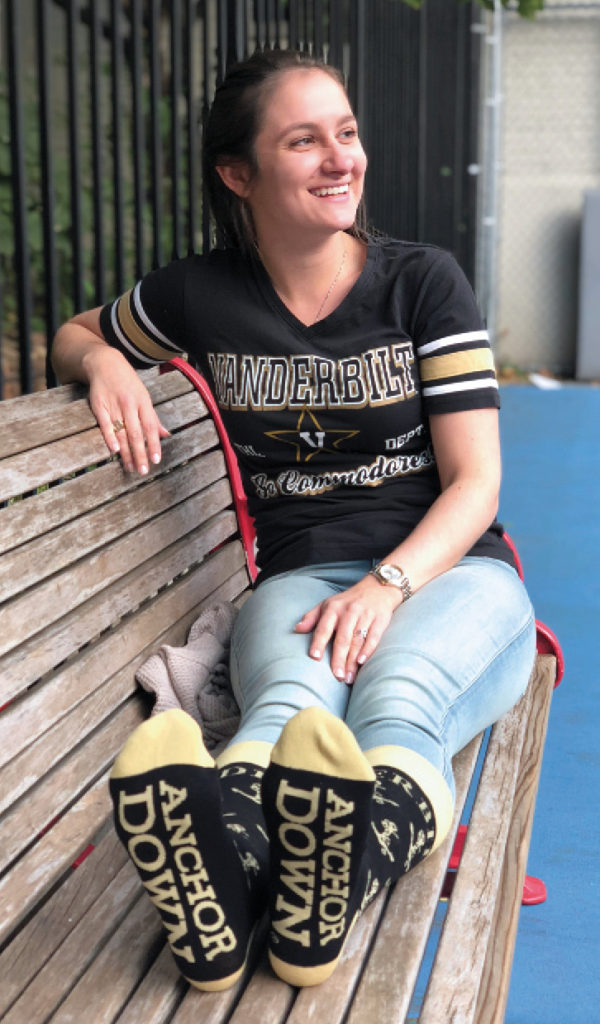"Sarah D'Amico, wearing black and gold Vanderbilt socks that say ""Anchor Down"""