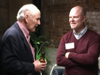 Alan Hicks, BA'66, left, speaks with Strong Inside author Andrew Maraniss, BA'92, at the San Francisco Commodore Classroom event.