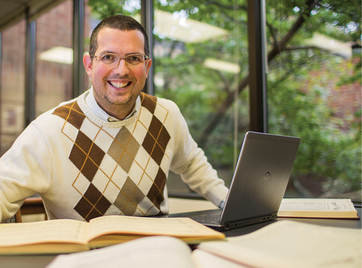 Prof. Douglas Shadle with laptop at the Wilson Music Library