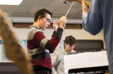 Junior Nicholas Heilborn conducts his commissioned piece with chatterbird musicians.