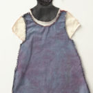 Mixed media assemblage of clothes for a young black woman