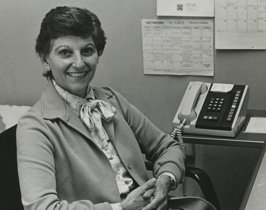 black and white photo of Nancy Ransom sitting in her office in the 1970s