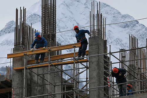 photo of workers constructing a building in Sochi, Russia