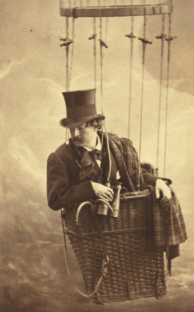 vintage photograph of man with binoculars in a hot air balloon