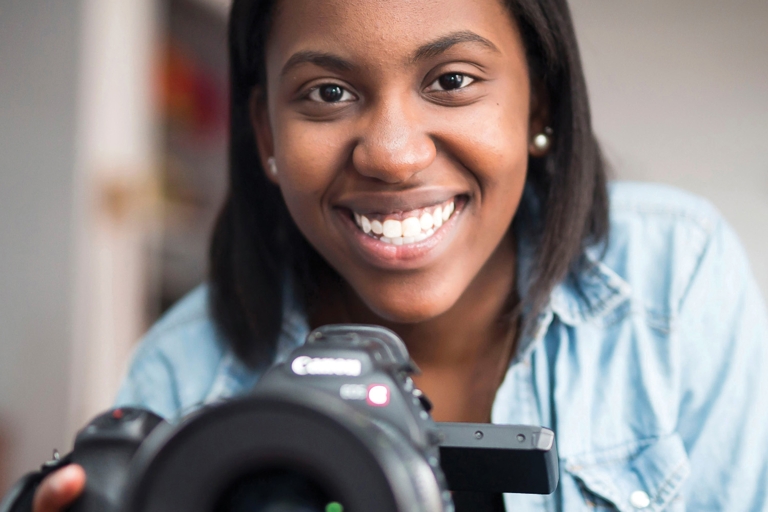 photo of Briana Francois holding a camera