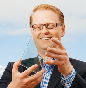 Miles Barr, co-founder and CEO of Ubiquitous Energy, demonstrates the innovative transparent coating that someday may revolutionize how solar energy is harnessed. Barr received the 2016 Young Alumni Professional Achievement Award from the Vanderbilt Alumni Association. (LEAH FASTEN)