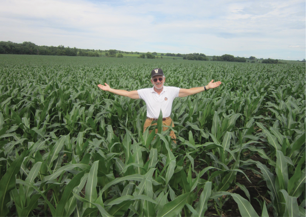 In this photo taken by Chuck Offenburger, BA'69, Paul Kurtz admires an Iowa cornfield on his way to watching the Commodores in the deciding game of the 2014 College World Series.