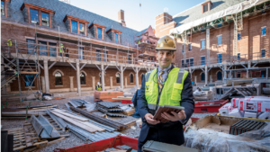 Vice Chancellor for Administration Eric Kopstain tours one of the four courtyards planned for E. Bronson Ingram College, which is set to open this fall to sophomores, juniors and seniors. (JOHN RUSSELL)