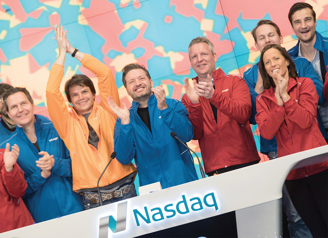 Friedman, right, celebrates the opening bell with executives from travel company Trivago on Dec. 16, 2016, the first day its shares began trading on Nasdaq. (COURTESY OF NASDAQ)