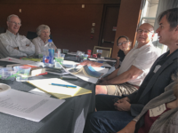 Rick Hilles, far right, leads a  writing workshop seated next to Steve Garrison and his daughter.