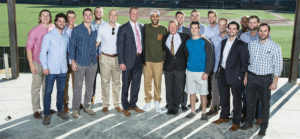 Corbin surrounded by former players who turned out for the event (JOE HOWELL)