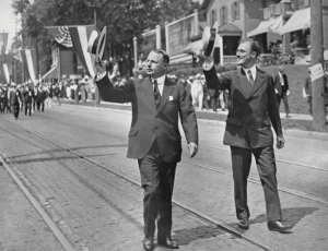 Presidential candidate James M. Cox, governor of Ohio and founder of Cox Enterprises, left, leads the Ohio Democratic Notification Parade in Dayton, Ohio, in 1920 with vice presidential candidate Franklin D. Roosevelt. (BETTMANN/GETTY)