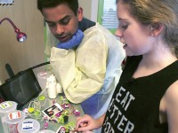 With materials and inspiration from Gokul Krishnan's mobile Makerspace cart, 14-year-old Vanderbilt Children's Hospital patient Daelyn James has invented an innovative device to help children with cystic fibrosis (CF) dry their nebulizers. Here James, who has CF herself, demonstrates the device to Krishnan. (SUVRO BANERJI/CBS NEWS)