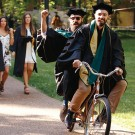 Photo of graduates on tandem bicycle
