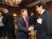 Chancellor Nicholas S. Zeppos, right, speaks with U.S. Rep. Chuck Fleischmann (R-Tenn.) at Vanderbilt's congressional reception  in Washington, D.C.,  in June. (AARON CLAMAGE)