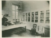 Pharmacist Clarence H. Taylor in the dispensary of Vanderbilt Hospital Unit S, Nevers, France, 1918