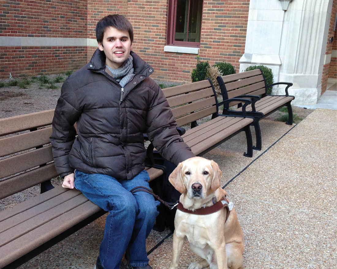 photo of Kelby Carlson and his service dog, Elvis