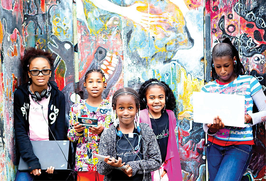Photo of young African American girls with computers