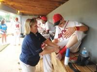 Vanderbilt Sports Medicine trainer Michelle Johnson tends to an injury  during an Overton  High School baseball game. (JOE HOWELL)
