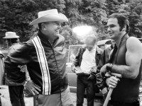James Dickey, left, and Burt Reynolds chat during the filming of Deliverance in 1971. Dickey appeared in the film as the sheriff of the fictitious town of Aintry, while Reynolds played Lewis, the hard-edged Atlanta suburbanite whose canoe trip with his friends ends in tragedy. (Everett Collection)