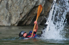 """Muller retired from slalom kayak competition in 2003, but he still enjoys """"throwing ends"""" and """"surfing green slabs"""" on the local river with his kids. (Jeb Wallace-Brodeur)"""