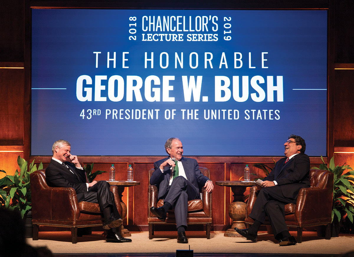 photo of President George W. Bush, Chancellor Nicholas S. Zeppos, and John Meacham talking on stage