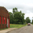 photo of boarded-up building in a small town in decline