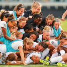 photo of soccer players celebrating in a dogpile