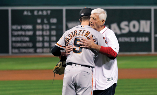 photo of Mike and Carl Yastrzemski embracing on the field