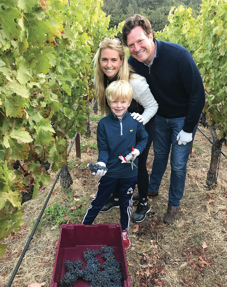 photo of McCartney and Jay Wilkins with their son at a vineyard
