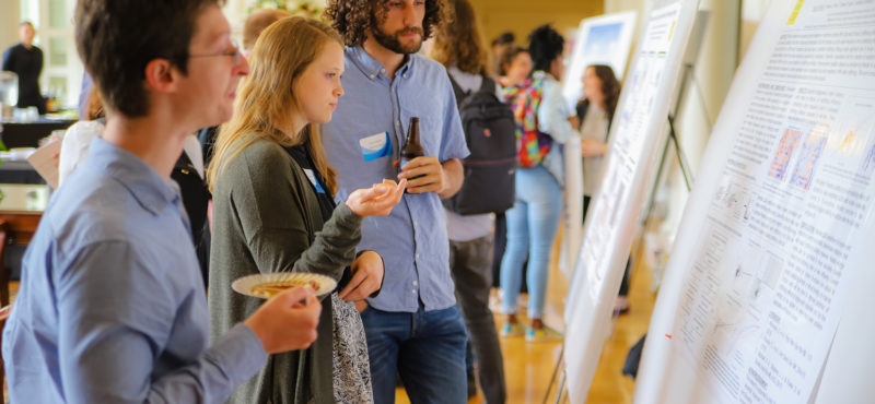 Ben, Hope and Johnny studying a poster at the 2019 CPBP Spring Retreat