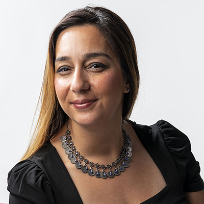 Headshot of Houra Merrikh wearing a necklace and black dress.