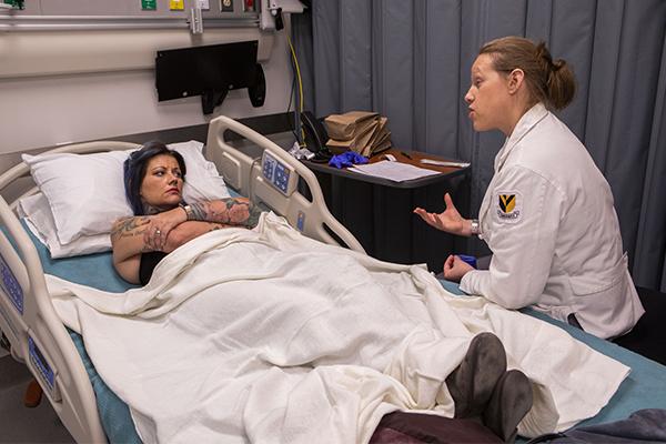 """Vanderbilt SANE student Eden Vinyarszky (right) talks to a """"patient"""""""