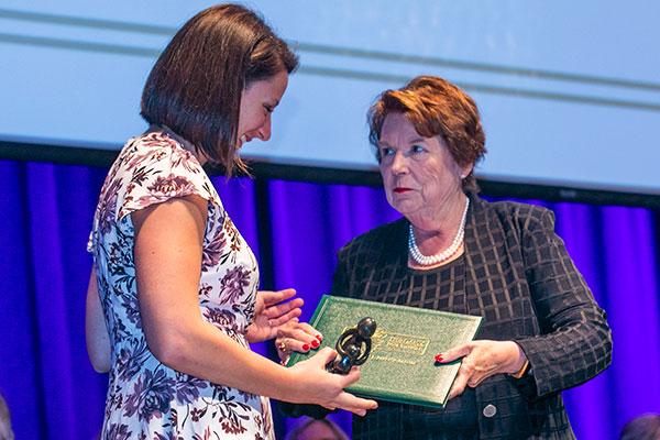 Genevieve Beninati receives DAISY Award from Dean Linda Norman