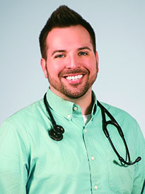 Joshua Thornberry in mint button down shirt with stethoscope around his nec;