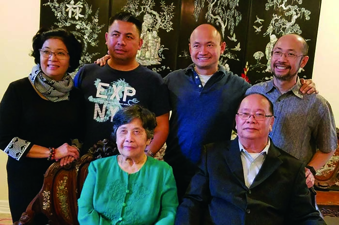 Duc Pham and his family, all Vietnamese, in a family photo. His mother and father sit in the front; Duc, two brothers and one sister stand behind them.