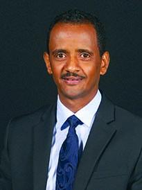 Headshot of Mogos Mulubrhan