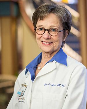 Vanderbilt nurse researcher Mary Jo Gilmer in white coat in lobby of Monroe Carell Children's Hospital