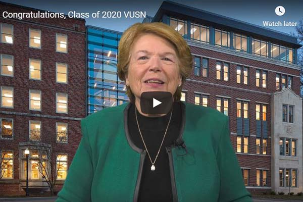 Play video icon is on top of photo of Dean Linda Norman in front of VUSN building