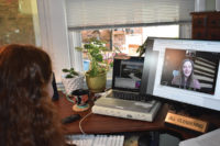 Patient talks to nurse practitioner via computer from home using telehealth